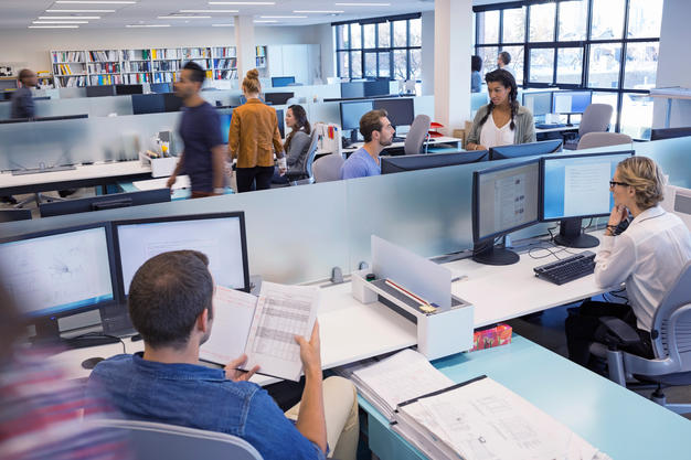 busy people in open concept office space