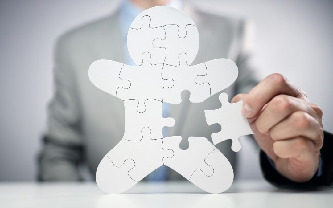 Businessman assembling jigsaw puzzle human team employee